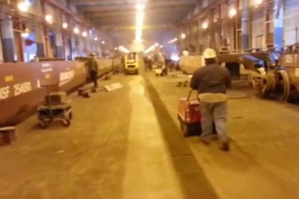 Sweeping a dusty manufacturing plant with a pedestrian sweeper